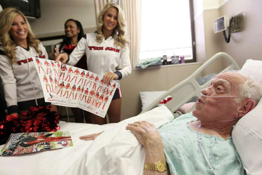 Glenn Spencer whistles while asked what he thinks about getting Houston Texans Cheerleaders calender while they pay him a visit at Methodist Outpatient Center on Thursday, Jan. 3, 2013, in Houston. Spencer has been in the hospital for two and a half weeks. Patients received a Division Championship t-shirt, autographed copy of the Houston Texans Cheerleader calender. Photo: Mayra Beltran, Houston Chronicle / © 2012 Houston Chronicle