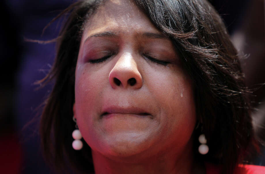 Dr. Melanie Lawson sheds a tears while praying during a protest in response to the acquittal of George Zimmerman in the death of Florida teen Trayvon Martin at Houston City Hall on Saturday, July 20, 2013. Photo: Mayra Beltran, Houston Chronicle / © 2013 Houston Chronicle