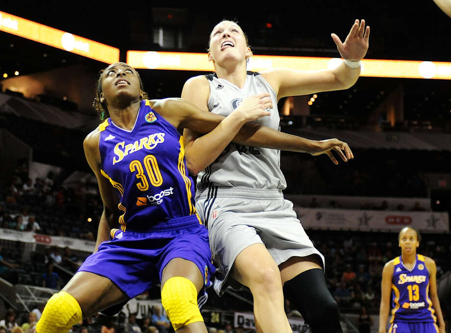 Nneka Ogwumike (left), battling with the Stars' Jayne Appel, and her Los Angeles Sparks are still searching for an owner. Photo: John Albright / For The Express-News / San Antonio Express-News