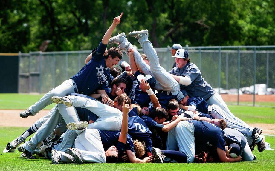The Argyle Liberty Christian Warriors celebrate after a 6-1 victory over the St. Pius Panthers during their TAPPS 5A State-Final matchup at Red Murff Field Tuesday, May 14, 2013, in Belton. Photo: Cody Duty, Houston Chronicle / © 2013 Houston Chronicle