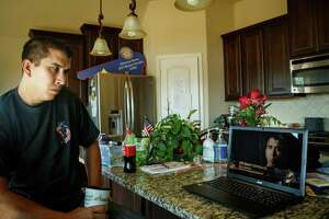 """Retired Marine Sgt. Marty Gonzalez watches a recording of himself on the Miltary Channel's Ultimate Warfare Episode: """"Fallujah: The Taking of Terror Central."""""""