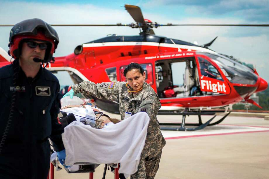 Staff Sgt. Marie-Claire Glidden uses a manual resuscitator to provide ventilation to a patient being transported into the Texas Trauma Institute from a Life Flight helicopter at Memorial Hermann Hospital in Houston.  The program, an ongoing effort, grew out of an Army analysis of operations in Iraq and Afghanistan that showed advanced training of flight medics would improve patient outcomes. Photo: Smiley N. Pool, Houston Chronicle / © 2013  Houston Chronicle