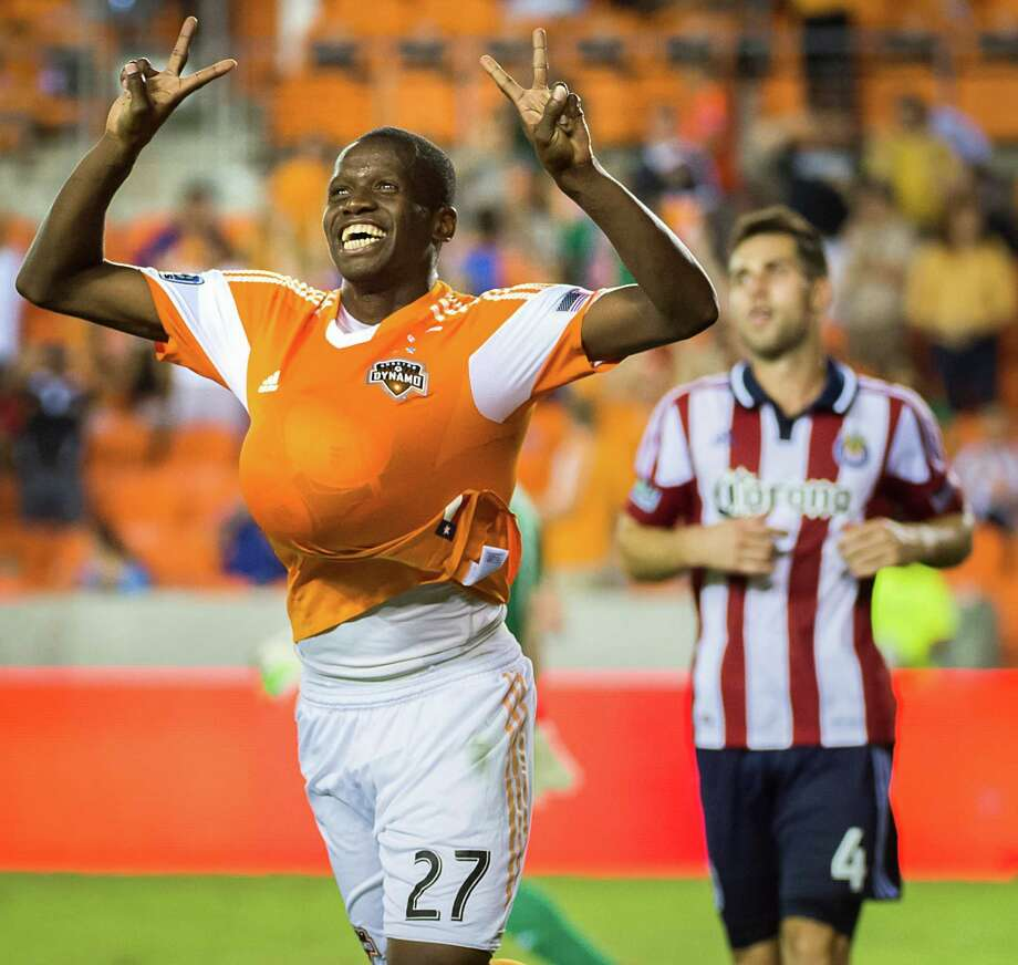 Houston Dynamo midfielder Boniek Garcia celebrates in front of Chivas USA defender Carlos Bocanegra (4) after scoring on a penalty kick  during the second half in MLS action on Saturday, Sept. 21, 2013, at BBVA Compass Stadium in Houston. The Dynamo won the game 5-1. Photo: Smiley N. Pool, Houston Chronicle / © 2013  Houston Chronicle