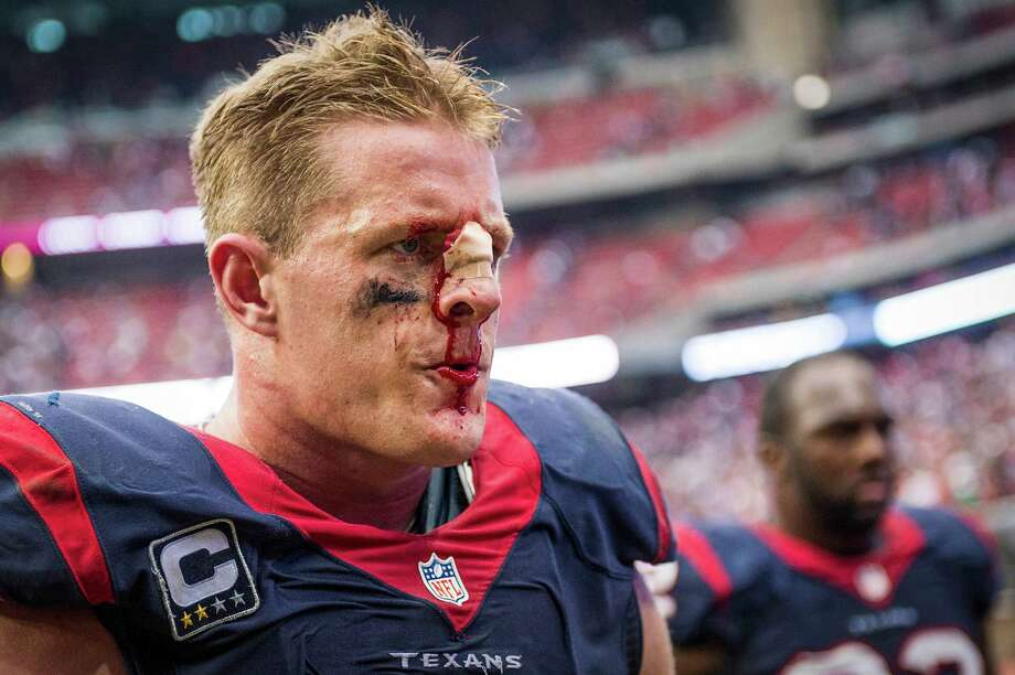 Houston Texans defensive end J.J. Watt leaves the field after a loss to the Seattle Seahawks in an NFL football game on Sunday, Sept. 29, 2013, in Houston. Photo: Smiley N. Pool, Houston Chronicle / © 2013  Houston Chronicle