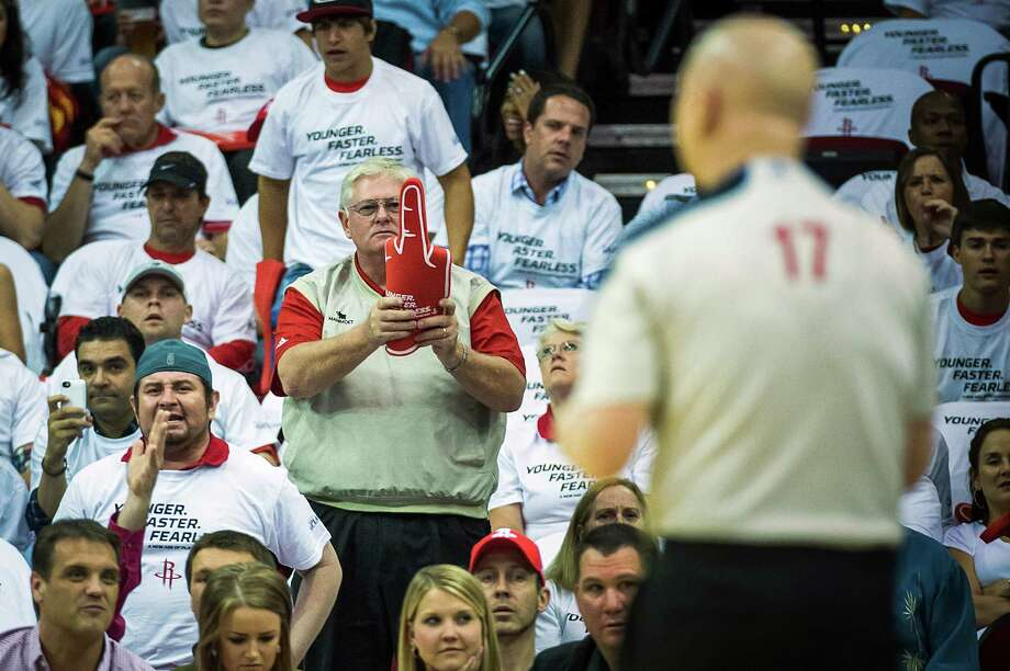 A Houston Rockets fan twists a foam 3-point hand into an obscene gesture toward referee Joe Crawford during the first half of Game 3 of a Western Conference first-round playoff series against the Oklahoma City Thunder at Toyota Center on Saturday, April 27, 2013, in Houston. Photo: Smiley N. Pool, Houston Chronicle / © 2013  Houston Chronicle