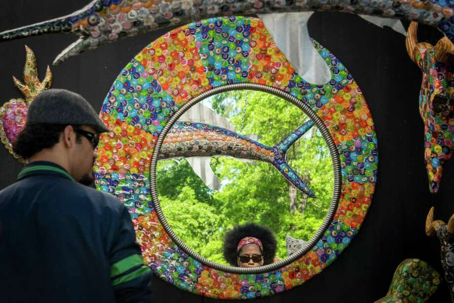 Visitors check out works by artist Dakota Pratt, of Austin, at the Bayou City Art Festival in Memorial Park on Sunday, March 24, 2013, in Houston. Photo: Smiley N. Pool, Houston Chronicle / © 2013  Houston Chronicle
