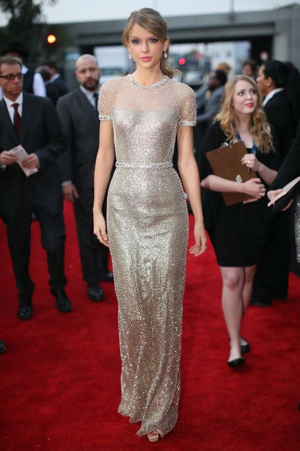 Hit: Taylor Swift was purely statuesque. The short sleeves and belt are just enough detail, and the pony kept it youthful.  (Photo by Christopher Polk/Getty Images for NARAS) Photo: Christopher Polk, Getty Images For NARAS