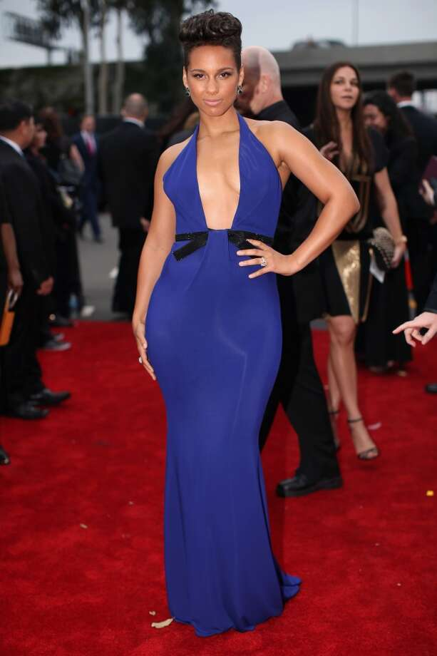 Hit: Alicia Keys in a beautiful blue halter and rock 'n' roll pompadour knows what's flattering.  (Photo by Christopher Polk/Getty Images for NARAS) Photo: Christopher Polk, Getty Images For NARAS