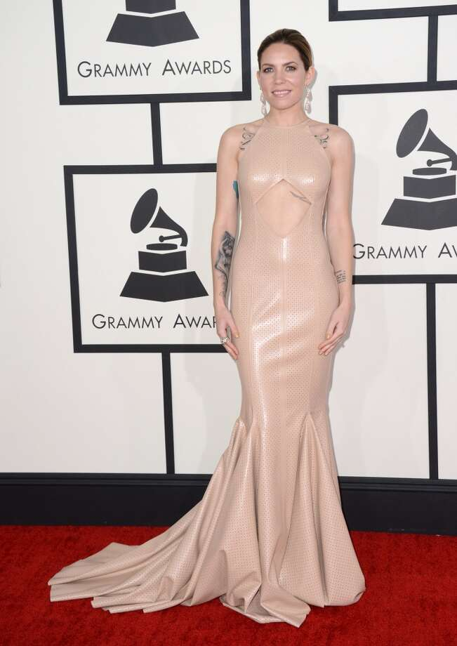 "Miss: Skylar Grey looks like all she's wearing is half-finished tattoos. A skin-tone matching dress is not the best iteration of ""the natural look."" (Photo by Jordan Strauss/Invision/AP) Photo: Jordan Strauss, Associated Press"