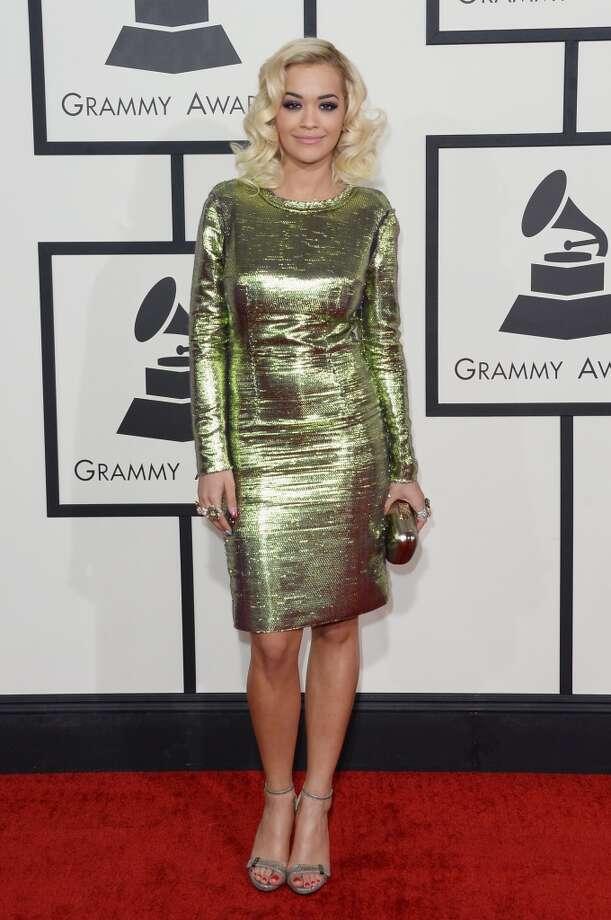 Hit: Although Rita Ora's short, 'Mad Men'-esque dress is a touch informal for the occasion, she still stuns in loose curls.  (Photo by Jason Merritt/Getty Images) Photo: Jason Merritt, Getty Images