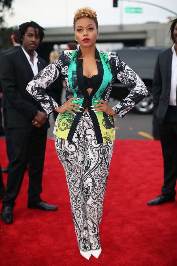 Miss: Chrisette Michele's suit is cool, but the print isn't the most flattering, and showing your bra under your jacket isn't entirely original. (Photo by Christopher Polk/Getty Images for NARAS) Photo: Christopher Polk, Getty Images For NARAS