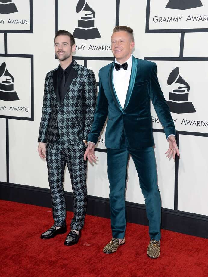 Hit: Macklemore (right), pictured with Ryan Lewis, dressed like a winner in a teal velvet coat.   (Photo by Jason Merritt/Getty Images) Photo: Jason Merritt, Getty Images