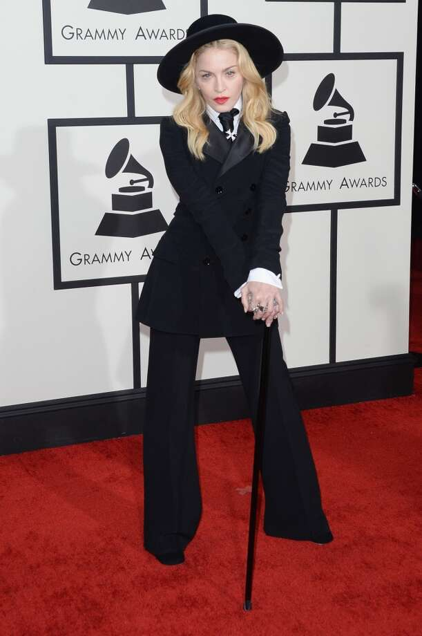 Hit: Madonna dressed like the grand dame she is, ruling the red carpet in a suit and cane. (Photo by Jason Merritt/Getty Images) Photo: Jason Merritt, Getty Images