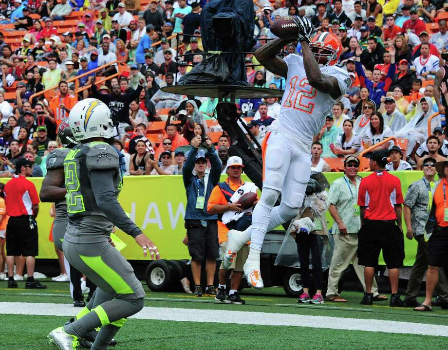 Browns wide receiver Josh Gordon, a Baylor product representing Team Rice, hauls in a TD catch to help beat Team Sanders 22-21 at the Pro Bowl in Honolulu. Photo: Scott Cunningham / Getty Images / 2014 Getty Images