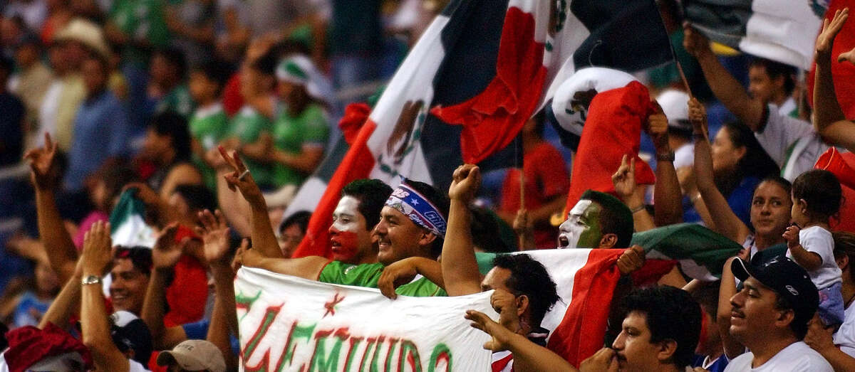 Mexico fans cheer in the second half of their World Cup Qualifier Saturday, June 19, 2004 at the Alamodome. BAHRAM MARK SOBHANI / STAFF