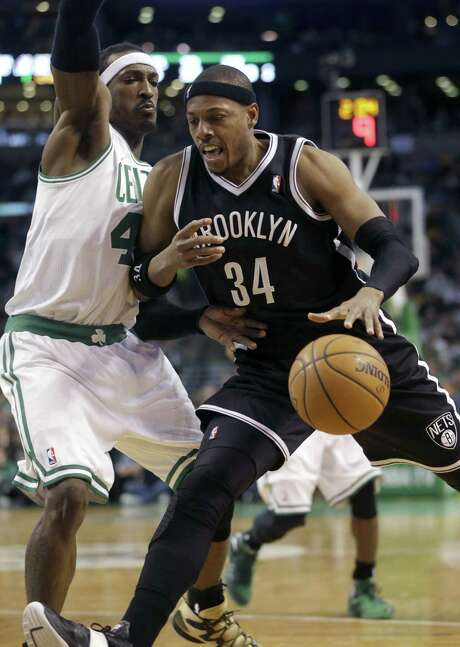 Brooklyn's Paul Pierce, limited to six points, tries to drive against Boston's Gerald Wallace. Photo: Steven Senne / Associated Press / AP