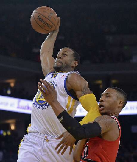 Warriors forward Andre Iguodala goes up for a dunk against Trail Blazers guard Damian Lillard. Iguodala had 12 points, 10 rebounds and five assists. Photo: Jose Carlos Fajardo / Contra Costa Times / Contra Costa Times