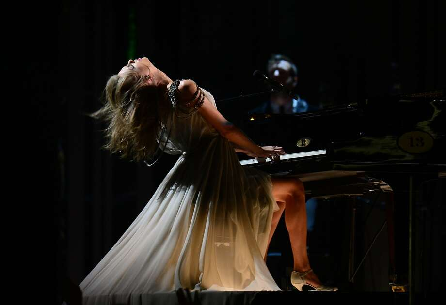 "Taylor Swift performs her weepy piano ballad ""All Too Well"" an hour into the 56th annual Grammy Awards in Los Angeles. Photo: Frederic J. Brown, AFP/Getty Images"