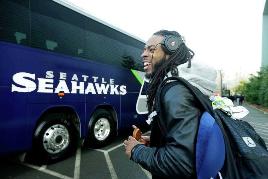 Seattle Seahawks cornerback Richard Sherman leaves team headquarters in Renton, Wash., Sunday, Jan. 26, 2014, to board a bus for his flight to play the Denver Broncos in the NFL Super Bowl XLVIII football game in East Rutherford, N.J. (AP Photo/Ted S. Warren) Photo: Ted S. Warren, STF / AP