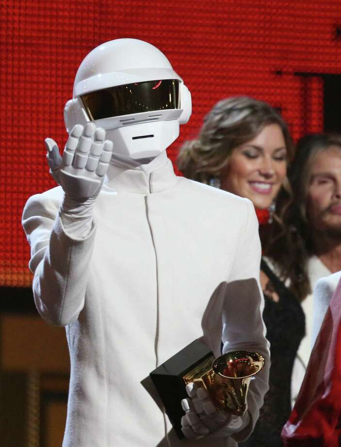 """Thomas Bangalter of Daft Punk accepts the Grammy for record of the year for """"Get Lucky."""" Photo: Matt Sayles / Invision / AP / Invision"""