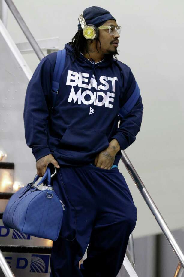 Running back Marshawn Lynch was one of the Seahawks who opted for more casual attire for the trip to New Jersey on Sunday. Photo: Julio Cortez, STF / AP
