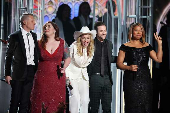 "Macklemore, from left, Mary Lambert, Madonna, Ryan Lewis and Queen Latifah appear onstage during the 56th Grammy Awards while 33 couples in the audience get married. Madonna sang ""Open Your Heart"" during the wedding ceremony."