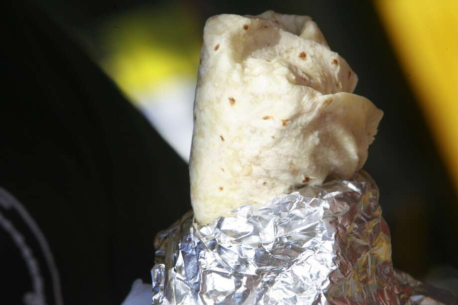 Eat a burrito with your hands, knife and fork is only for emergencies. Photo: Costantini, Mark, The Chronicle