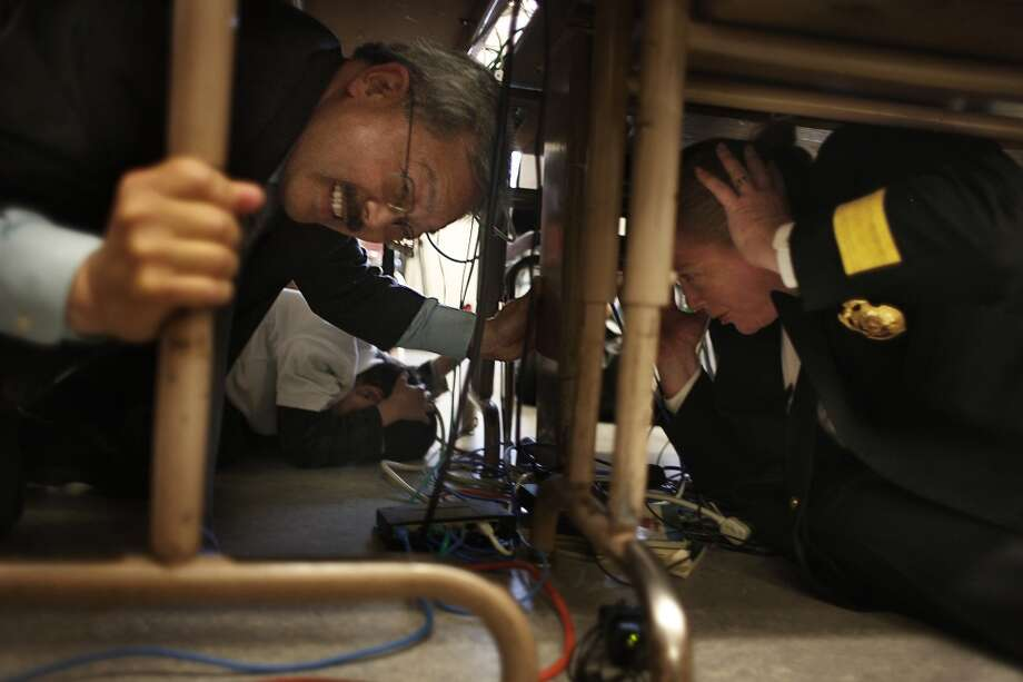 Get so accustomed to earthquakes, if somebody asks 'did you feel that?' your response is 'I guess.' Pictured: Mayor Ed Lee and Fire Chief Joanne Hayes-White participate in an earthquake drill in 2011. Photo: Lea Suzuki, The Chronicle