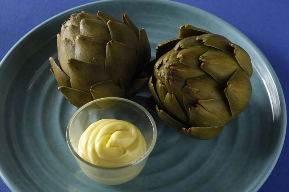 Learn the proper way to eat an artichoke, and always use lots of garlic. Photo: Craig Lee, Special To The Chronicle