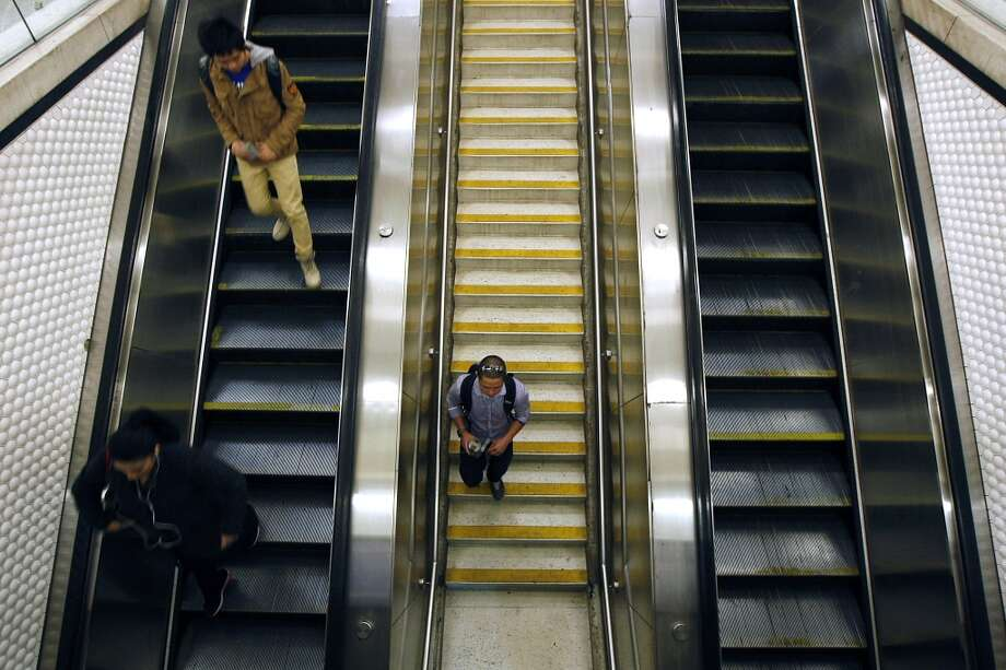 Stand on the right or walk on the left side of that escalator. Don't stand on the left! Photo: Michael Short, The Chronicle