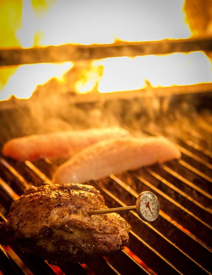 Meat and fish on the grill at Penrose in Oakland. Photo: John Storey, Special To The Chronicle