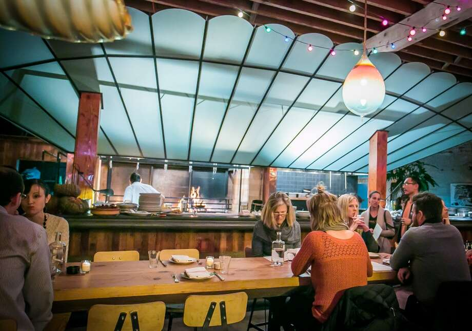 Diners enjoy dinner at Penrose in Oakland. Photo: John Storey, Special To The Chronicle