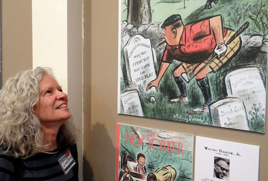 Linda Darrow, daughter of artist Whitney Darrow Jr., gazing at New Yorker magazine cover art the Westporter created at the opening Sunday of Westport Historical Society's exhibits on the town's ties to the magazine over the years. Photo: Mike Lauterborn / Westport News contributed