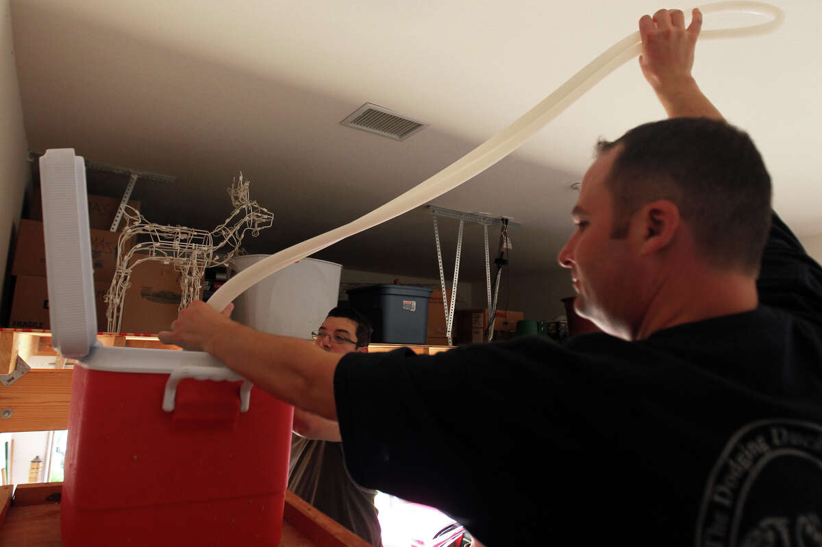 Founder Michael DiCicco works on a batch of Red Wheat in his garage brew set up. DiCicco is one of four partners in the upcoming Busted Sandal Brewing Company.