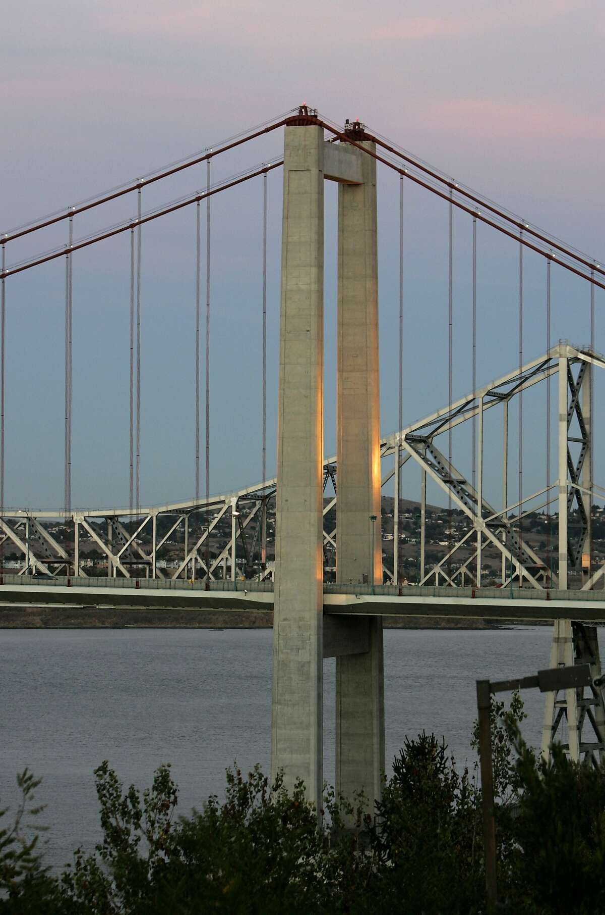 Sunset colors fill the sky behind the Carquinez Bridge in Crockett on Wednesday October 18, 2006.