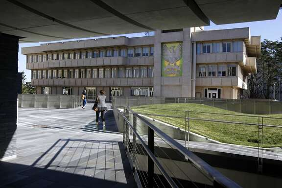 Students walk towards the University Center (background) from the new John Lo Schiavo Center for Science and Innovation and the Koret Garden Courtyard on the USF campus in San Francisco, Calif. on Wednesday, Jan. 22, 2014.