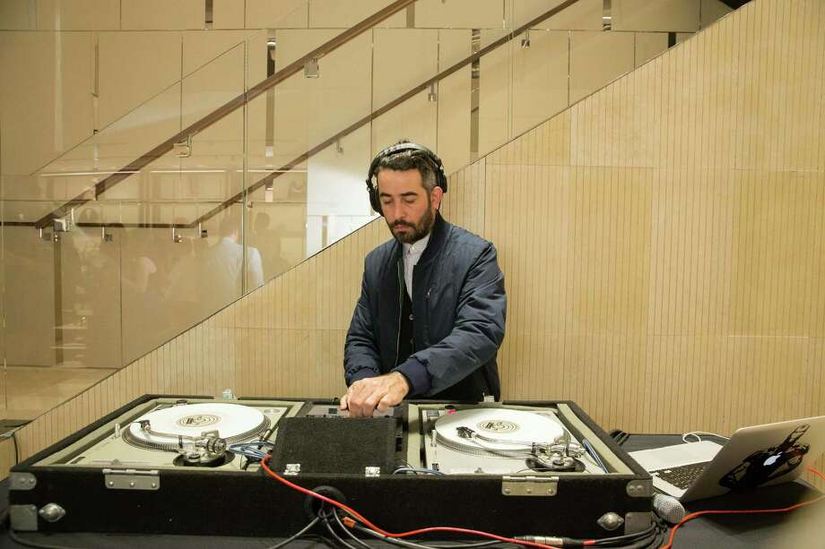 The DJ spins during the opening cocktail reception of the newly relocated Salvatore Ferragamo boutique in S.F. on January 23, 2014. Photo: Drew Altizer, Drew Altizer Photography / ©2014 byDrew Altizer all rights reserved
