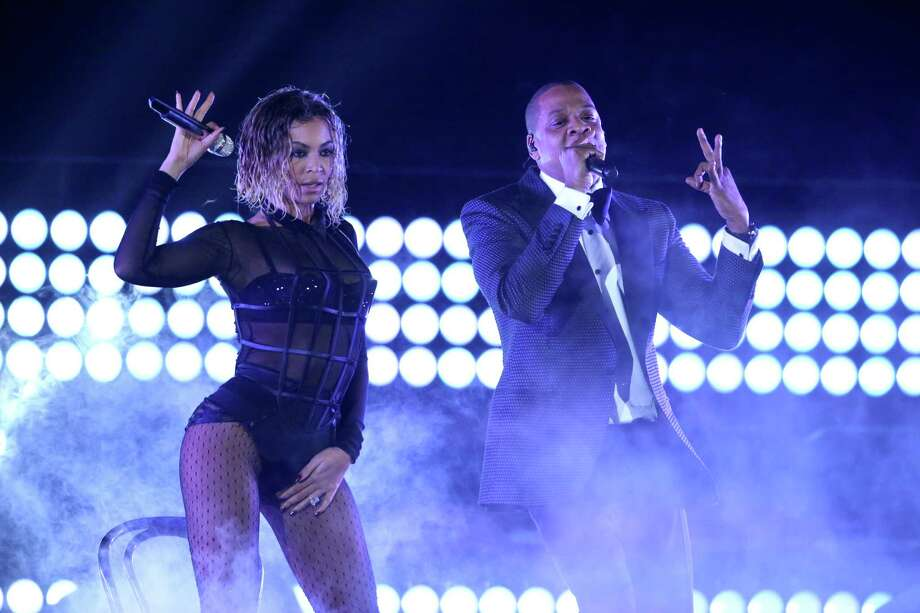 "Beyonce, left, and Jay-Z perform ""Drunk in Love"" at the 56th annual Grammy Awards at Staples Center on Sunday, Jan. 26, 2014, in Los Angeles. (Photo by Matt Sayles/Invision/AP) Photo: Matt Sayles, Matt Sayles/Invision/AP / Invision"