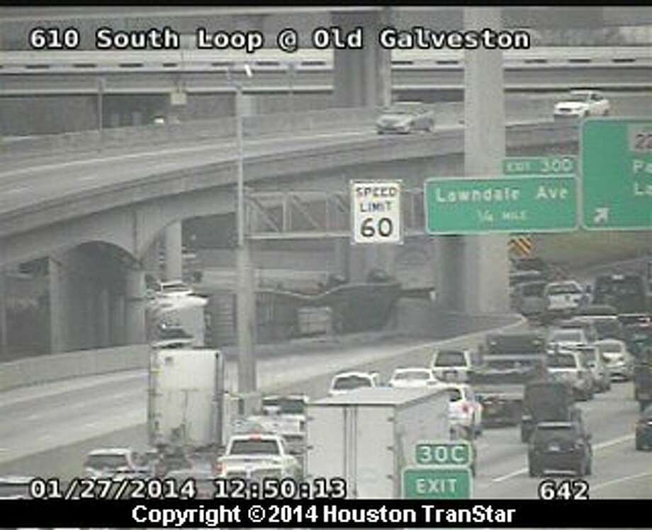 Portions of a the eastbound South Loop near the La Porte Freeway were blocked after an 18-wheeler overtunred about 12:30 p.m. Monday. Photo: Houston Transtar