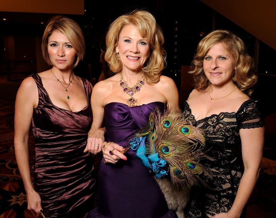 From left: Jennifer Clements, women of distinction Lisa Simon and Camella Clements at the Carnevale di Venezia Winter Ball  benefitting the Crohn's and Colitis Foundation at the Hilton Americas Hotel Saturday  Jan 25, 2014.(Dave Rossman photo) Photo: Dave Rossman, For The Houston Chronicle