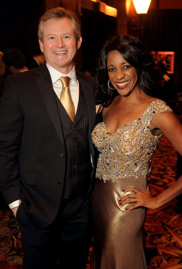 Jason Cain and former woman of distinction Jacqui Baly at the Carnevale di Venezia Winter Ball  benefitting the Crohn's and Colitis Foundation at the Hilton Americas Hotel Saturday  Jan 25, 2014.(Dave Rossman photo) Photo: Dave Rossman, For The Houston Chronicle