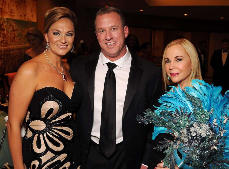 From left: Woman of Distinction Rachel Regan, Tom Regan and Carolyn Farb at the Carnevale di Venezia Winter Ball  benefitting the Crohn's and Colitis Foundation at the Hilton Americas Hotel Saturday  Jan 25, 2014.(Dave Rossman photo) Photo: Dave Rossman, For The Houston Chronicle