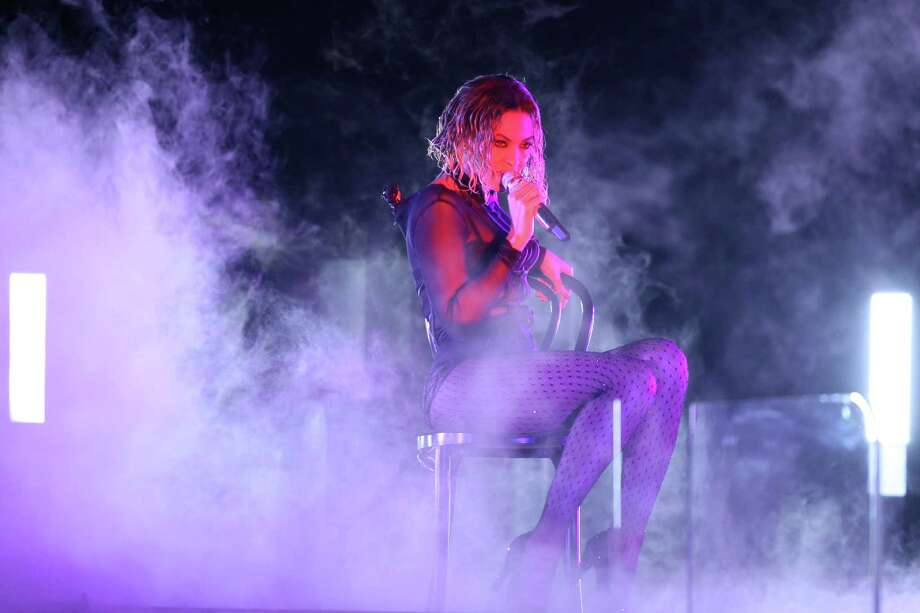 """Beyonce performs """"Drunk in Love"""" at the 56th annual Grammy Awards at Staples Center on Sunday, Jan. 26, 2014, in Los Angeles. (Photo by Matt Sayles/Invision/AP) ORG XMIT: CACJ204 Photo: Matt Sayles / Invision"""