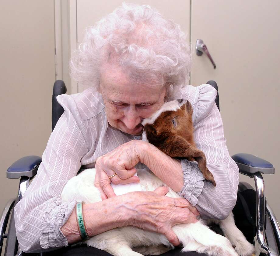 How 'bout a hug?Mildred Girard, a resident of ManorCare Health Services in Sunbury, Pa., spends some 