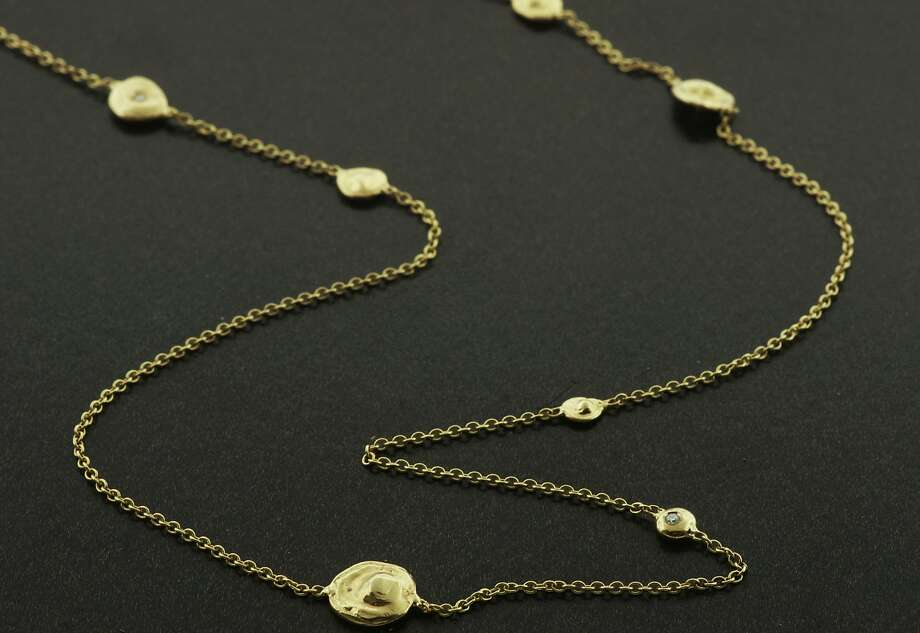 Pebble diamond necklace in 18-karat gold with tiny diamonds Photo: Christine Guibara