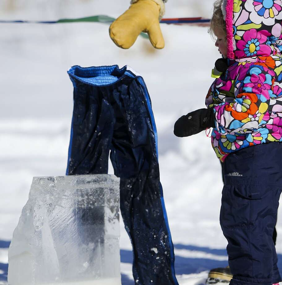 It's so cold in Minnesota (minus 15F) that wet pants are standing up by themselves during Ice Harvesting Day in 
