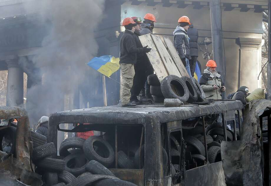 Protesters, who occupy three sizable buildings in central Kiev, guard barricades in the Ukraine capital. Photo: Efrem Lukatsky, Associated Press