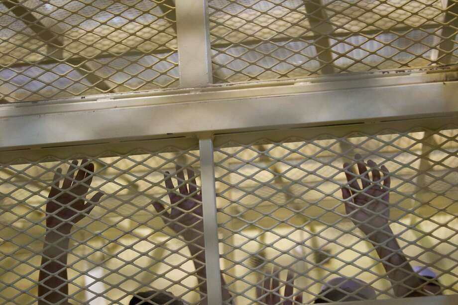 FILE - In this Monday, Sept. 27, 2010 file photo reviewed by the U.S. military, detainees stand inside a cell inside the U.S. run Parwan detention facility near Bagram north of Kabul, Afghanistan. The Afghan government has begun the process of releasing three dozen prisoners, officials said Monday, Jan. 27, 2014, despite U.S. protests that they are highly dangerous, the latest sign of deteriorating relations between the two countries ahead of the year-end withdrawal of most international combat troops. (AP Photo/David Guttenfelder, File) Photo: David Guttenfelder, Associated Press
