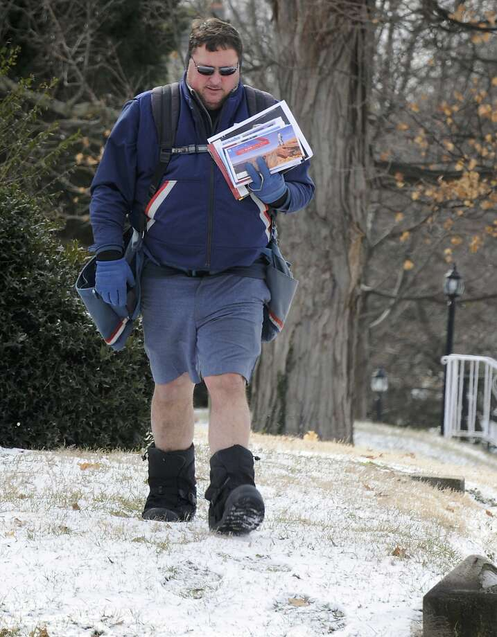 Neither snow nor rain nor gloom of night stays this courier from showing off his legs: With temperatures 