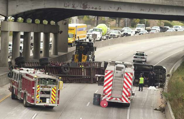 Officials work the scene of a big rig roll over on the southbound lanes of the east loop near the La Porte freeway on Monday, Jan. 27, 2014, in Houston. Photo: J. Patric Schneider, For The Chronicle / © 2014 Houston Chronicle